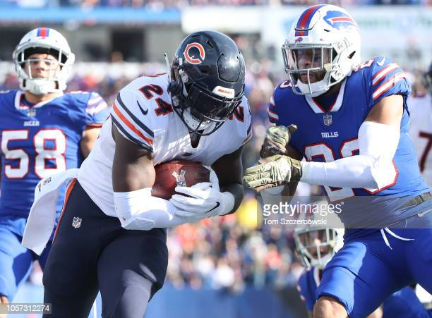 Jordan Howard of the Chicago Bears rushes for his second touchdown as he is hit by Micah Hyde of the Buffalo Bills during NFL game action at New Era...
