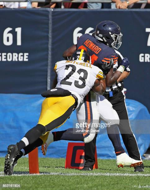 Jordan Howard of the Chicago Bears scores the gamewinning touchdown in overtime past Mike Mitchell of the Pittsburgh Steelers at Soldier Field on...
