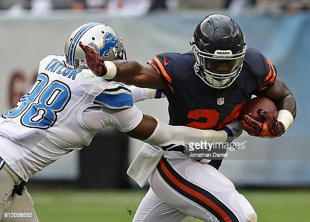Jordan Howard of the Chicago Bears tries to break away from Devin Taylor of the Detroit Lions at Soldier Field on October 2 2016 in Chicago Illinois