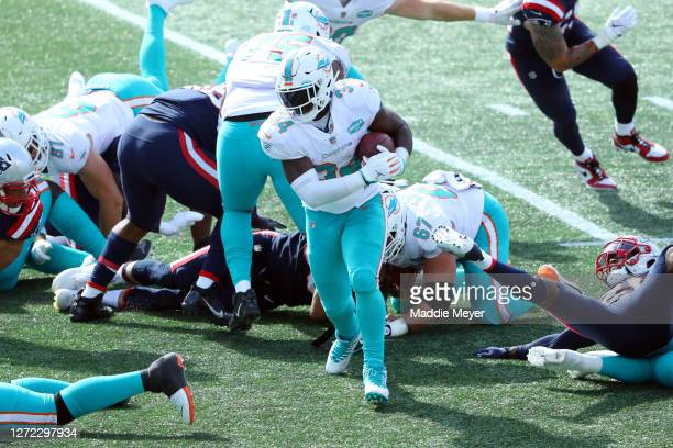 Jordan Howard of the Miami Dolphins runs with the ball during the second half against the New England Patriots at Gillette Stadium on September 13,...