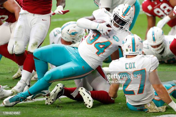 Jordan Howard of the Miami Dolphins scores a touchdown during the first half against the Arizona Cardinals at State Farm Stadium on November 08, 2020...