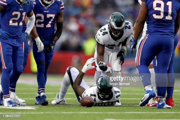 Jordan Howard of the Philadelphia Eagles assists Alshon Jeffery of the Philadelphia Eagles during the third quarter of an NFL game against the...