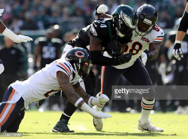 Jordan Howard of the Philadelphia Eagles carries the ball as Roquan Smith and Ha Ha Clinton-Dix of the Chicago Bears defend in the first quarter at...