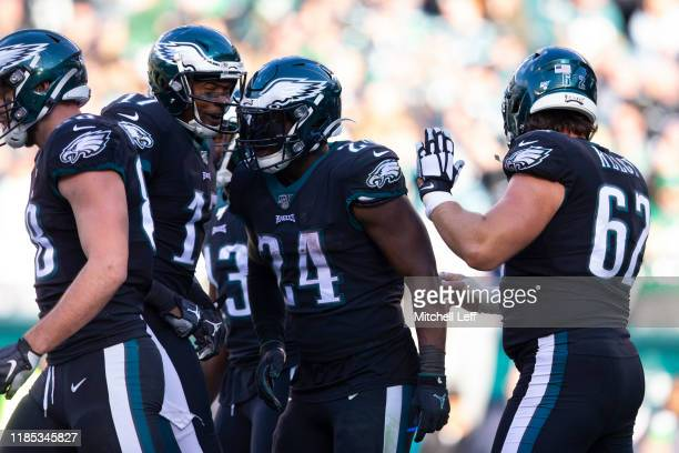 Jordan Howard of the Philadelphia Eagles celebrates with Dallas Goedert Alshon Jeffery and Jason Kelce after scoring a touchdown against the Chicago...