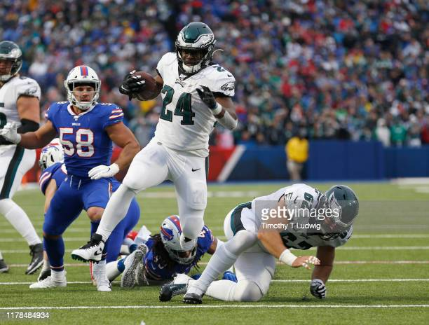 Jordan Howard of the Philadelphia Eagles jumps to avoid a tackle by Tremaine Edmunds of the Buffalo Bills during the second half at New Era Field on...