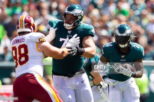 Jordan Howard of the Philadelphia Eagles runs the ball as Brandon Brooks blocks Matthew Ioannidis of the Washington Redskins at Lincoln Financial...