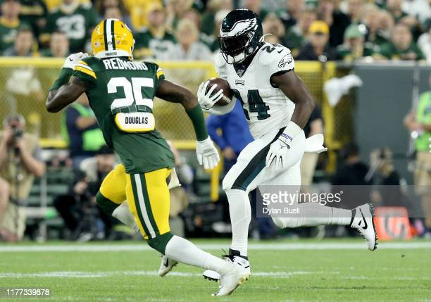 Jordan Howard of the Philadelphia Eagles runs with the ball while being chased by Will Redmond of the Green Bay Packers in the first quarter at...