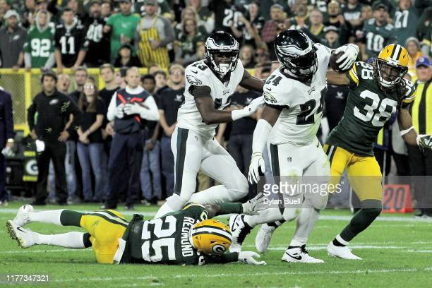 Jordan Howard of the Philadelphia Eagles runs with the ball while being tackled by Will Redmond of the Green Bay Packers in the second quarter at...