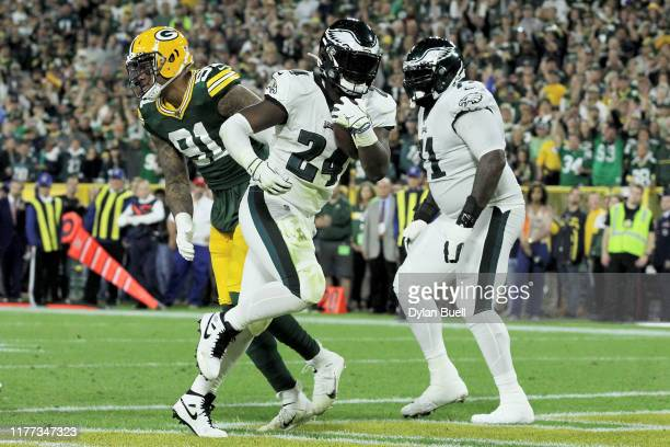 Jordan Howard of the Philadelphia Eagles scores a touchdown in the second quarter against the Green Bay Packers at Lambeau Field on September 26,...
