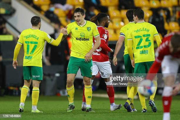 Jordan Hugill of Norwich City celebrates with team mate Emi Buendia after scoring their side's first goal during the Sky Bet Championship match...