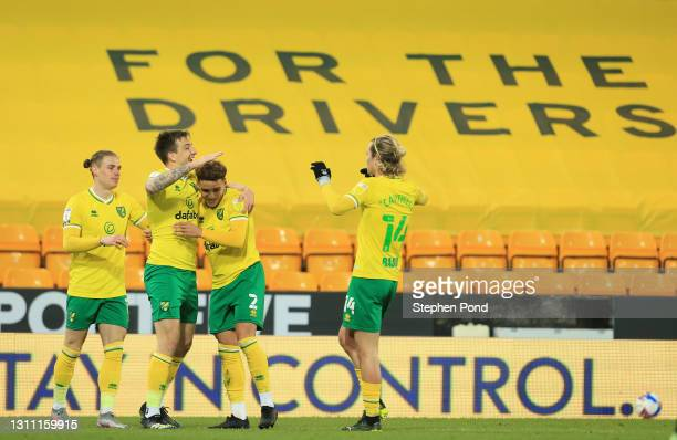 Jordan Hugill of Norwich City celebrates with teammates after scoring their team's seventh goal during the Sky Bet Championship match between Norwich...