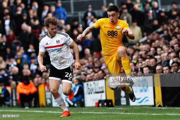 Jordan Hugill of Preston North End holds off the challenge of Tomas Kalas of Fulham during the Sky Bet Championship match between Fulham and Preston...