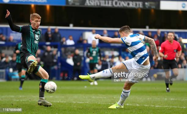 Jordan Hugill of Queens Park Rangers scores his team's first goal during the FA Cup Third Round match between Queens Park Rangers and Swansea City at...