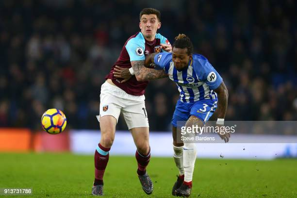 Jordan Hugill of West Ham United and Gaetan Bong of Brighton and Hove Albion battle for the ball during the Premier League match between Brighton and...
