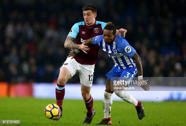 Jordan Hugill of West Ham United battles for possession with Gaetan Bong of Brighton and Hove Albion during the Premier League match between Brighton...