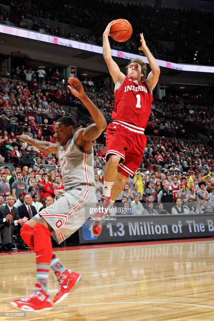 Jordan Hulls #1 of the Indiana Hoosiers completes a fast break for a layup over Lenzelle Smith, Jr. #32 of the Ohio State Buckeyes in the first half on February 10, 2013 at Value City Arena in Columbus, Ohio.