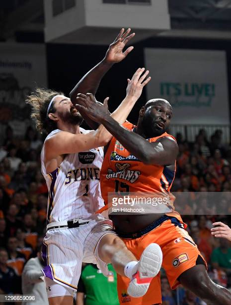 Jordan Hunter of the Kings contests the ball with Nathan Jawai of the Taipans during the round one NBL match between the Cairns Taipans and the...