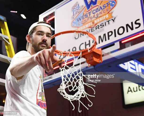 Jordan Hunter of the Saint Mary's Gaels gestures after cutting down a net following the team's 6047 victory over the Gonzaga Bulldogs to win the...