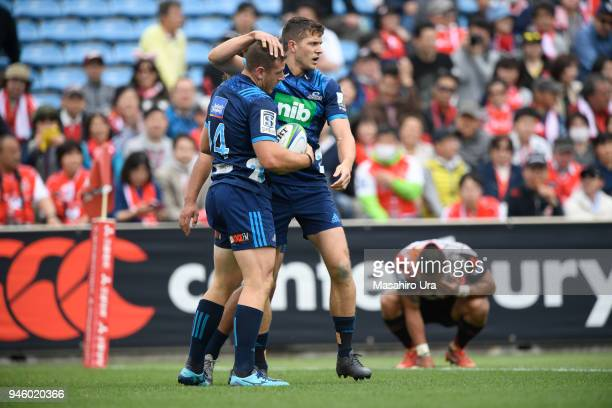 Jordan Hyland of Blues celebrates with his team mate after scoring a try during the Super Rugby Round 9 match between the Sunwolves and the Blues at...