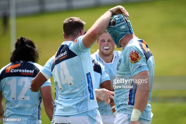 Jordan Hyland of Northland scores a try and celebrates with the team during the round 10 Mitre 10 Cup match between Northland and Otago at Semenoff...