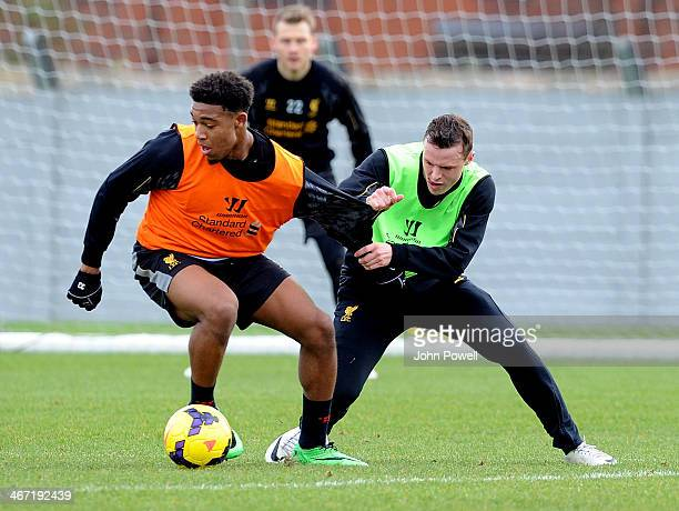 Jordan Ibe and Brad Smith of Liverpool in action during a training session at Melwood Training Ground on February 6 2014 in Liverpool England