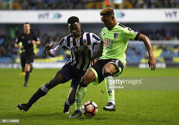 Jordan Ibe of AFC Bournemouth and Fred Onyedinma of Millwall compete for the ball during the Emirates FA Cup third round match between Millwall and...