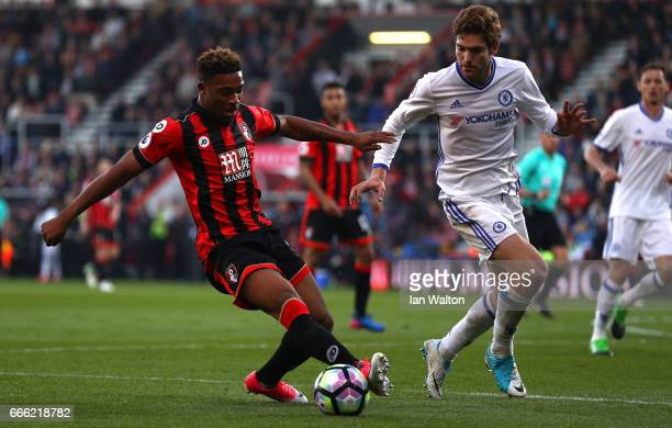 Jordan Ibe of AFC Bournemouth attempts to take the ball past Marcos Alonso of Chelsea during the Premier League match between AFC Bournemouth and...