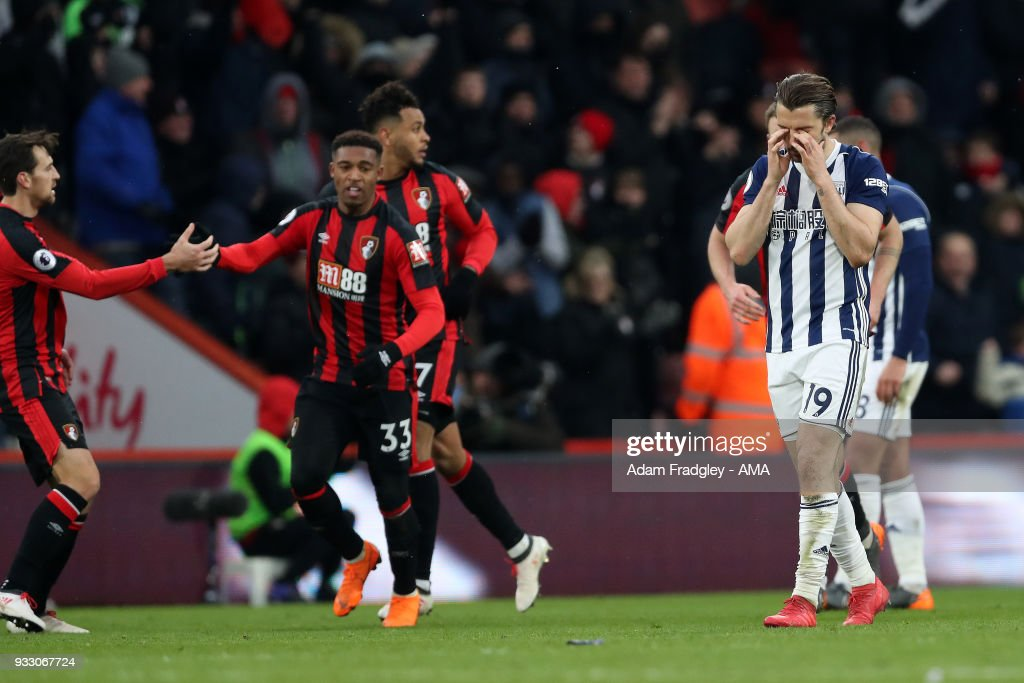 Jordan Ibe of AFC Bournemouth celebrates after scoring a goal to make it 1-1 as Jay Rodriguez of West Bromwich Albion reacts during the Premier League match between AFC Bournemouth and West Bromwich Albion at Vitality Stadium on March 17, 2018 in Bournemouth, England.