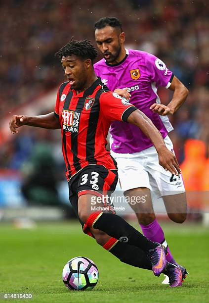 Jordan Ibe of AFC Bournemouth is put under pressure from Ahmed Elmohamady of Hull City during the Premier League match between AFC Bournemouth and...