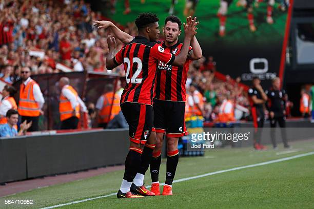 Jordan Ibe of Bournemouth is congratulated by team mate Adam Smith after scoring during a preseason match between Bournemouth and Cardiff City at...