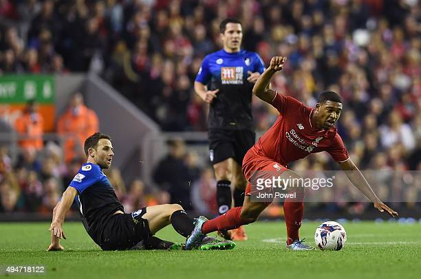 Jordan Ibe of Liverpool competes with Marc Pugh of AFC Bournemouth during the Capital One Cup Fourth Round match between Liverpool and AFC...