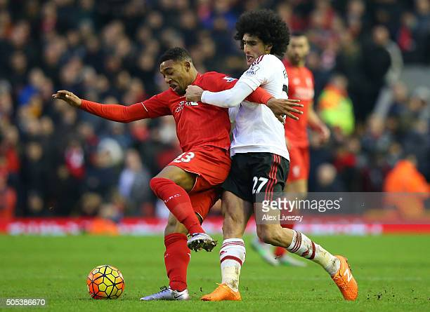 Jordan Ibe of Liverpool holds off a challenge from Marouanne Fellaini of Manchester United during the Barclays Premier League match between Liverpool...