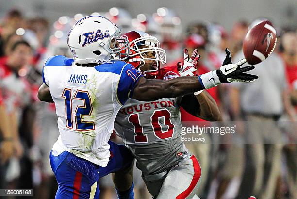 Jordan James of the Tulsa Golden Hurricane reaches for a pass as he is defended by Zachary McMillian of the Houston Cougars at Robertson Stadium on...