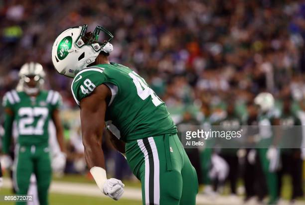 Jordan Jenkins of the New York Jets celebrates sacking quarterback Tyrod Taylor of the Buffalo Bills during the first quarter of the game at MetLife...