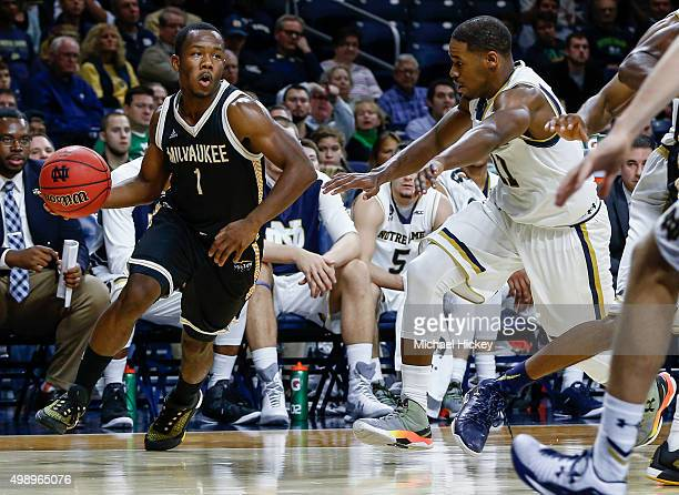 Jordan Johnson of the Milwaukee Panthers dribbles the ball around Demetrius Jackson of the Notre Dame Fighting Irish at Purcell Pavilion on November...