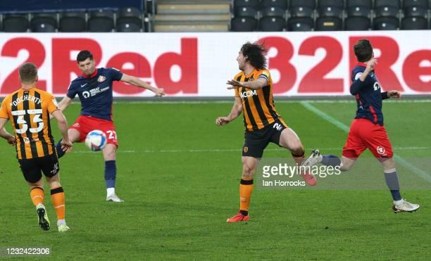 Jordan Jones of Sunderland scores the first goal the Sky Bet League One match between Hull City and Sunderland at the Kcom Stadium on April 20, 2021...