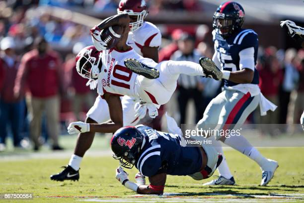 Jordan Jones of the Arkansas Razorbacks is tackled by DeMarquis Gates of the Ole Miss Rebels at Hemingway Stadium on October 28 2017 in Oxford...