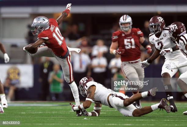 Jordan Jones of the Arkansas Razorbacks is tackled by Larry Pryor of the Texas A&M Aggies in the second half at AT&T Stadium on September 23, 2017 in...