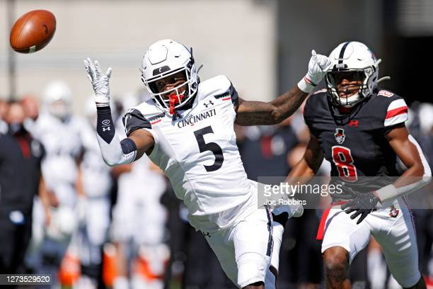 Jordan Jones of the Cincinnati Bearcats watches as a pass sails over his head while defended by Isaiah Norman of the Austin Peay Governors in the...
