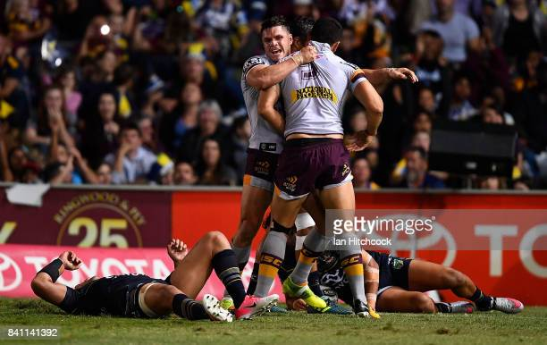 Jordan Kahu of the Broncos celebrates with James Roberts of the Broncos after scoring a try during the round 26 NRL match between the North...