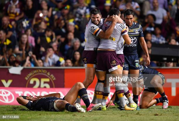 Jordan Kahu of the Broncos celebrates with team mates after scoring a try during the round 26 NRL match between the North Queensland Cowboys and the...