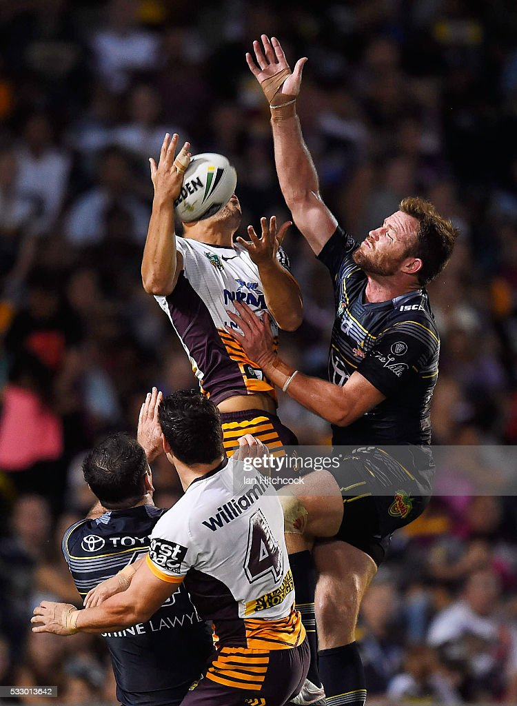 Jordan Kahu of the Broncos contests a high ball with Gavin Cooper of the Cowboys during the round 11 NRL match between the North Queensland Cowboys and the Brisbane Bronocs at 1300SMILES Stadium on May 20, 2016 in Townsville, Australia.