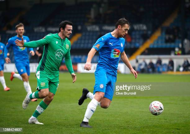 Jordan Keane of Stockport County is closed down by Chris Dagnall of Yeovil Town during the Emirates FA Cup Second Round match between Stockport...