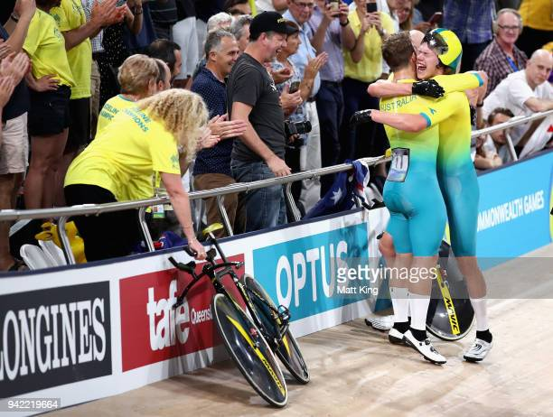 Jordan Kerby and Sam Welsford of Australia celebrate winning gold in the Men's 4000m Team Pursuit Gold Final during the Cycling on day one of the...