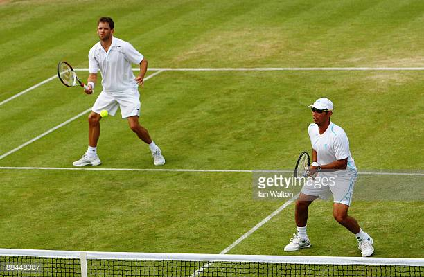 Jordan Kerr of Australia plays a forehand playing with Jeff Coetzee of South Africa during the men's doubles quarter final match against Mariusz...