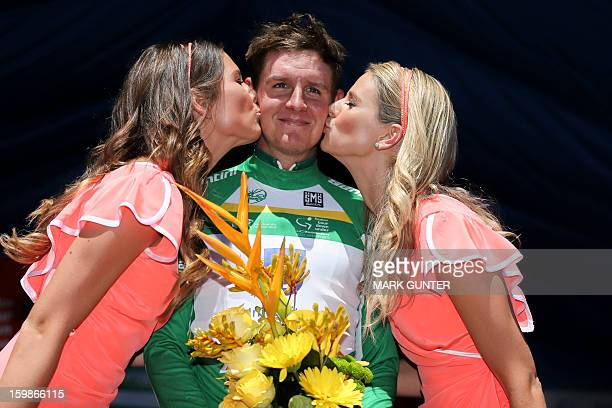 Jordan Kirby from Australia gets a kiss on the podium after winning the days Most Aggressive jersey for the 135km stage 1 of the Tour Down Under in...