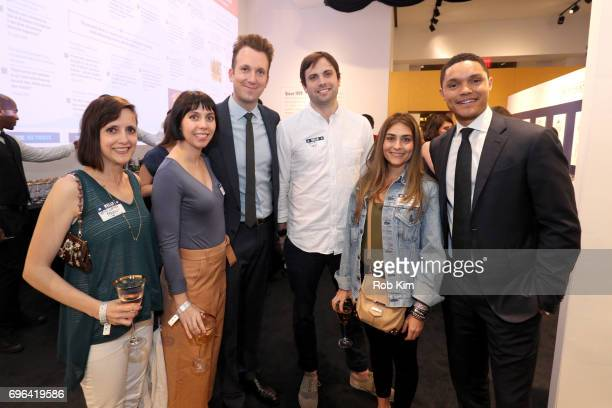 Jordan Klepper and Trevor Noah pose with Daily Show staff during the Donald J Trump Presidential Twitter Library Opening Reception presented by...