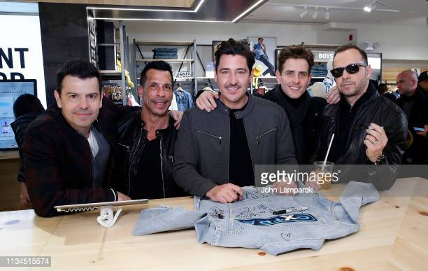 Jordan Knight Danny Mack Jonathan Knight Joey McIntyre and Donnie Whalberg of New Kids On The Block visit Extra at The Levi's Store Times Square on...