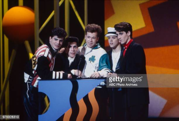 Jordan Knight Danny Wood Donnie Wahlberg Joey McIntyre Jonathan Knight New Kids On The Block receiving award on the 17th Annual American Music Awards...