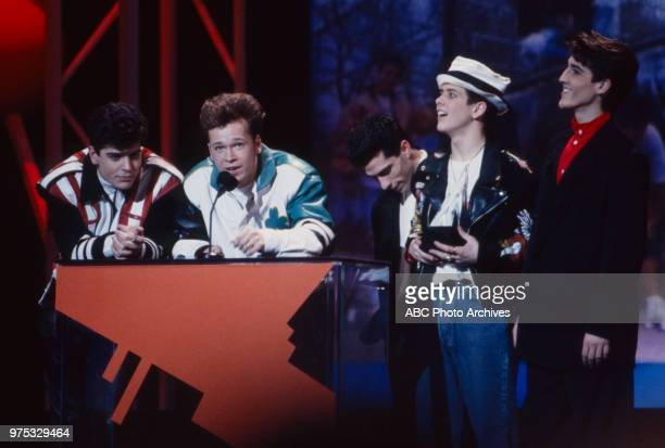 Jordan Knight Donnie Wahlberg Danny Wood Joey McIntyre Jonathan Knight New Kids On The Block receiving award on the 17th Annual American Music Awards...